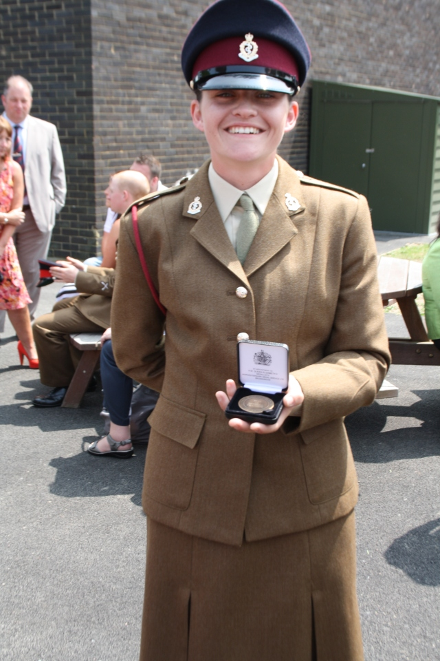 Proud, so very proud of her. She is holding a medal she was awarded for attaining the best fitness in the troop.