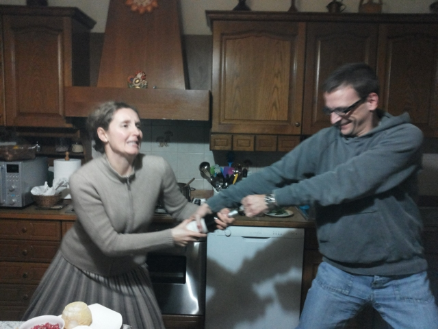 Our hosts trying to open the bottle of wine I brought
