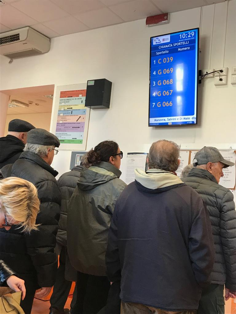 Italians queuing in a hospital